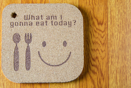 what to eat: wood texture write what am i gonna eat today concept on wooden background Stock Photo