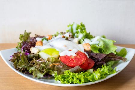 Fresh mixed vegetables salad, Salad dressing.