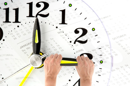 Deadline. hand trying to stop time. Time Management. Time pressure. Cure for old age. Annual reports. Front view.