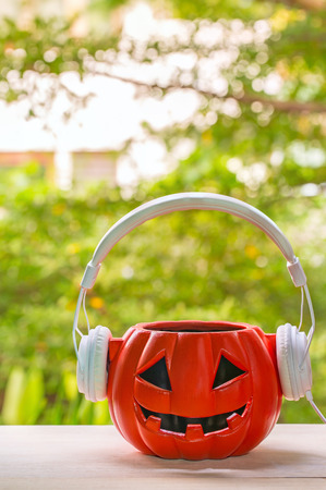 holiday music: Music lover pumpkin with smile and headphones. halloween day concept
