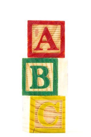 The wooden alphabet blocks on a white background
