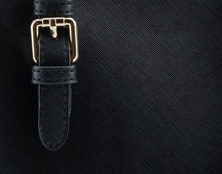 buckle: buckle on leather bag