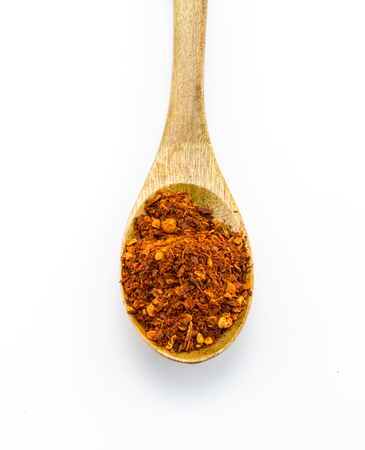 pepper flakes: Red pepper flakes in wooden spoon on white background Stock Photo