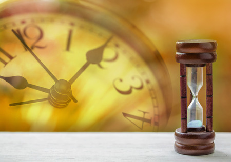 of moment: Sandglass on the wooden table Stock Photo