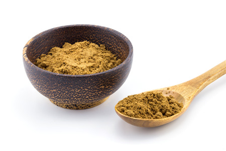 Wooden Spoon with Five Spice Powder and bowl on White Background