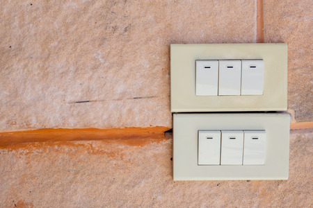 white light: White light switch on  cement wall