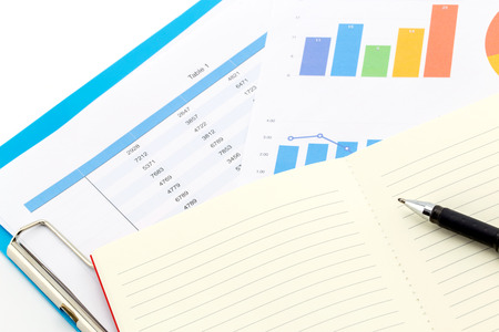 work book: financial charts and Business graphs, book and note on the table