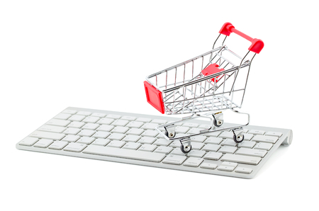 even: Shopping cart on white keyboard and graph show break even point, concept business