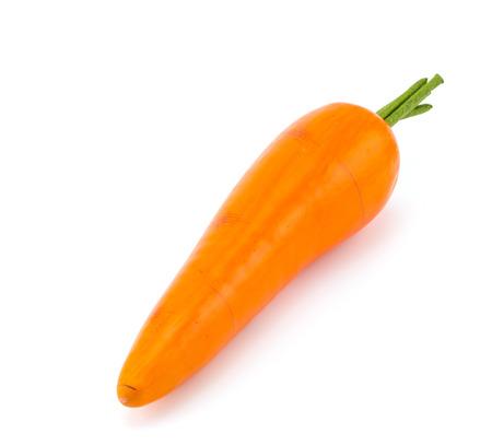 Close-up van een stuk speelgoed wortel op een witte achtergrond Stockfoto
