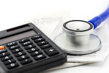 hospital expenses: Stethoscope, receipt and calculator, concept business financial Stock Photo