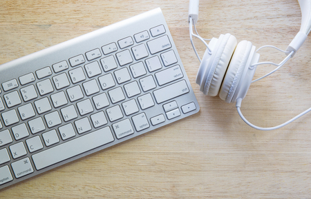 office headphones and white keyboard Archivio Fotografico