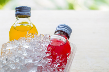 dew cap: bottle with tasty drink in ice Stock Photo