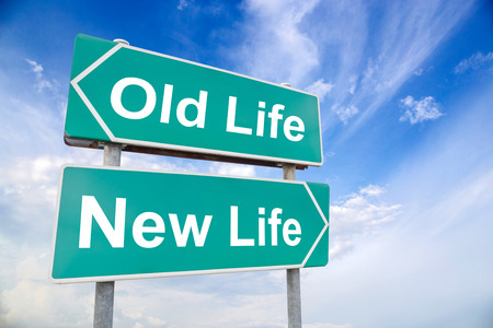 career life: New life old life road sign on sky background, business concept