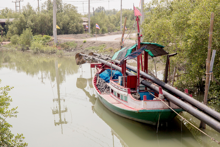 river banks: fishing boats line up on the river banks after returning from sea.