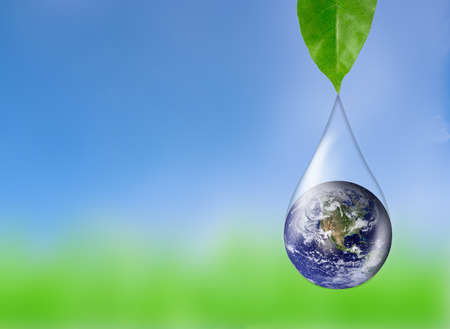 Earth in water drop reflection under green leaf, Elements of this image furnished by NASA