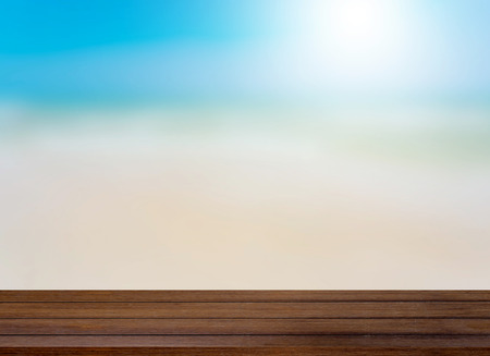 wooden floor: Wood table top on blurred beach background, summer concept - can be used for display or montage your products