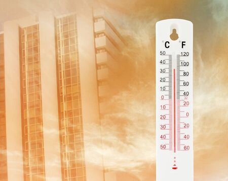 measured: Tropical temperature of 34 degrees Celsius, measured on an outdoor thermometer with tower background