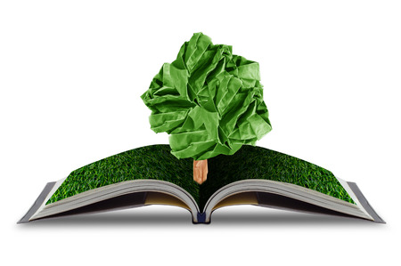 ree paper growing from book with grass on white background, concept conservation of the environment, environmental protection Stock Photo