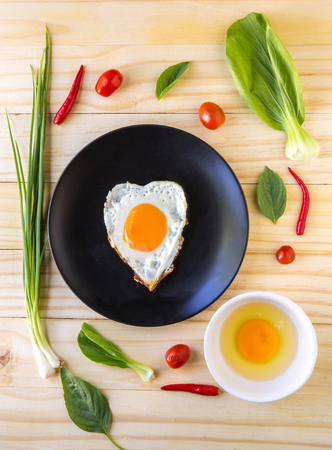 flay: Flay lay vegetables, herbs, spices and egg, Fried egg  on wood background.