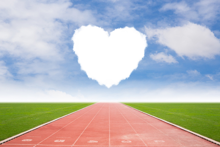 Running track in stadium with heart cloud shape Stock Photo