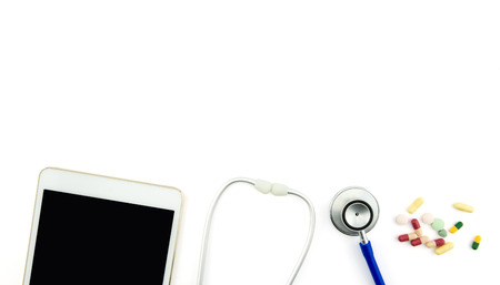 helthcare: Top view of doctor desk with digital tablet with empty screen. Top view of medical equipment, medicine, pills and stethoscope. Helthcare and healthy concept. Stock Photo