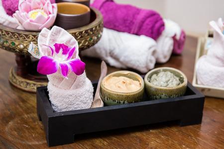 aroma facial: Aroma oil, facial cream, powder, towel on table, spa concept