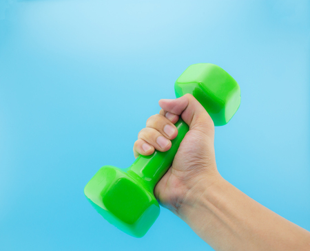 holding close: mans hand holding dumbbell. Close up, concept of healthy lifestyle Stock Photo