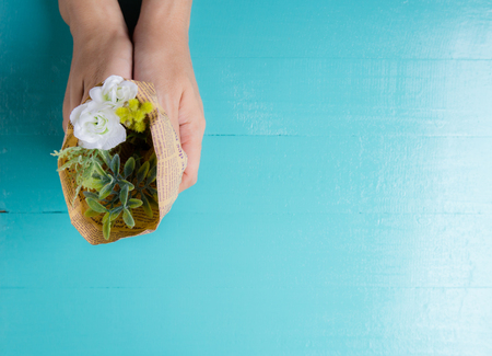 fake newspaper: Bouquet of beautiful fresh flower artificial wrapped in paper hold hand