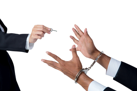 businessman in handcuffs and woman hand offering key solving business ideas concept isolated on white background