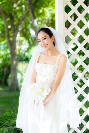 white: Asian bride at outdoor in a morning. Stock Photo