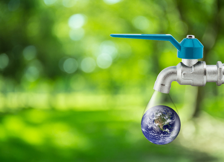 Water drop running from faucet tap Saving aqua reforestation conceptual - Element of the image furnished by NASA