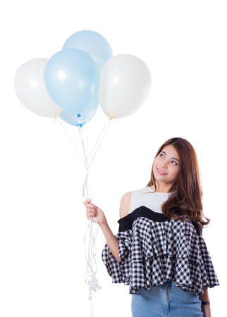 Young girl with balloons on a white background.