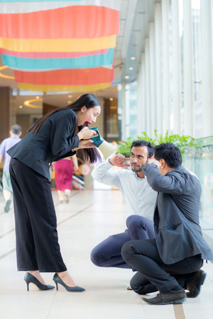 Young business woman working at the office, shouting and yelling in megaphone Stock Photo