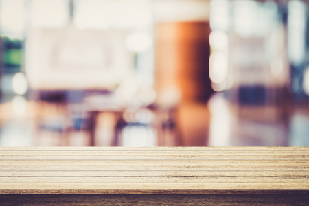 Empty wooden table with restaurant blur background - can be used for display your products.