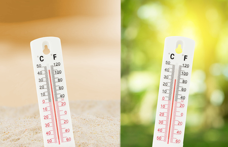 Tropical temperature, measured on an outdoors thermometer with compare between the nature environment concept. 免版税图像
