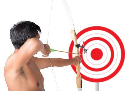 energy work: Asian man holding bow and shooting to archery target. Rear view, businessman aiming at target with bow and arrow, target success concept.