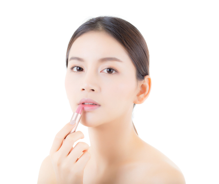 Lipstick makeup asian woman with lip balm care. Beauty Asian girl on lips with happy. cosmetics beauty concept.