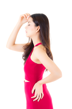 Beautiful young asian woman with red dress of portrait with beside isolated on white background. female model concept.