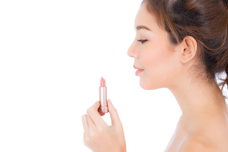Beauty asian woman applying make up with lipstick of mouth isolated on white background, Beautiful girl on lips with happy, skincare and cosmetic concept. Stock Photo
