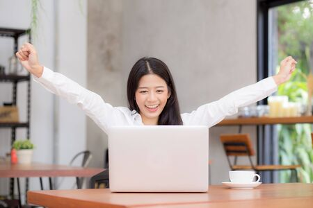 Asian young businesswoman excited and glad of success with laptop, career freelance business concept.