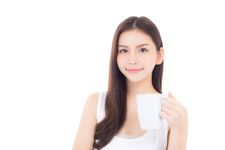 Beautiful portrait asian young woman smiling and drinking water glass with fresh and pure for diet, beauty girl thirsty and charming holding beverage with healthy isolated on white background, health care concept.