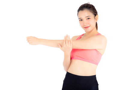 Beautiful portrait young asian woman standing stretch muscle arm isolated on white background, girl wear sport clothes exercise and yoga for health, wellness concept. Stock Photo