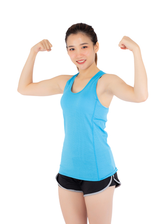 Beautiful portrait young asian woman wear sport clothes have strong and muscle with health, girl show biceps with exercise and workout for wellness isolated on white background, strength and fit concept. Stock Photo