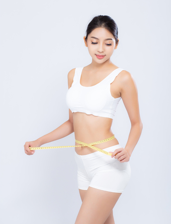 beautiful portrait asian woman diet and slim with measuring waist for weight isolated on white background, girl have cellulite and calories loss with tape measure, health and wellness concept.