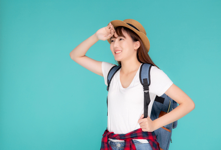Beautiful portrait young asian woman wear hat on head smile expression confident enjoy summer trip holiday isolated blue background, model girl fashion having backpack, travel concept.