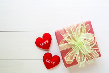 Holiday of gift box with bow ribbon on wooden white table, present of day on wood, vintage retro tone, 14 February of love day with romantic copy space, valentine concept, top view.