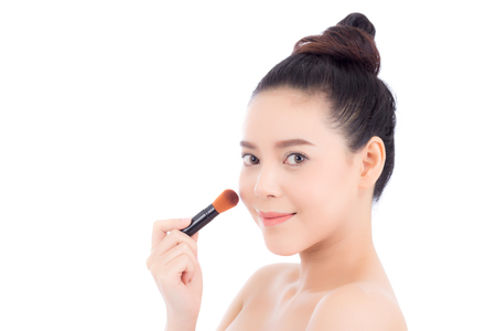 Beauty of portrait asian woman applying make up with brush of cheek isolated on white background, beautiful of girl holding blusher, skincare and cosmetic concept.