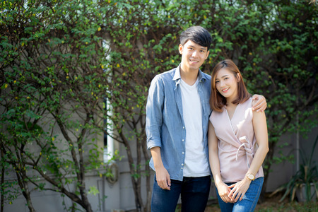 Beautiful portrait couple looking each others eyes and smiling with happy, young asian man and woman relation with love dating, husband and wife feeling and emotion, lovers and lifestyle concept.