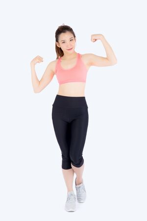 Beautiful portrait young asian woman wear sport clothes strong and muscle with health, girl show biceps with exercise and workout for wellness isolated on white background, strength and fit concept.