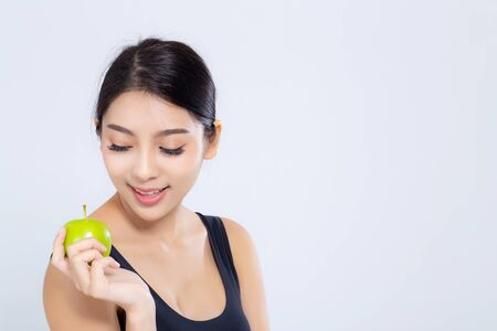 Portrait asian woman smiling holding green apple fruit and beautiful body diet with fit isolated on white background, girl weight slim with cellulite or calories, health and wellness concept. Stock fotó